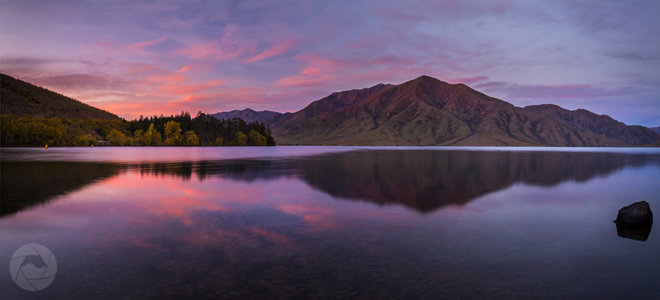 Lake Benmore reflections at sunset panorama, Canterbury, New Zealand