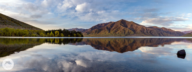 Lake Benmore daytime reflection panorama