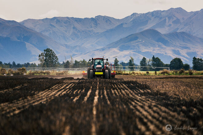 Seed drilling with mountain backdrop, Methven, Canterbury, New Zealand