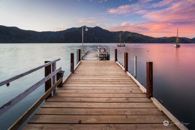 Sunset wharf at Bythells Bay, Marlborough Sounds, New Zealand
