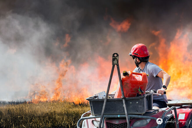 Checking on the burnoff, Canterbury, New Zealand