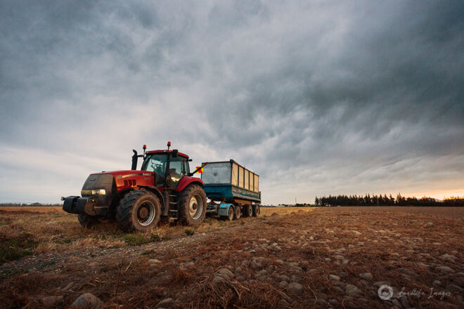 Tractor and trailer in worked field, Canterbury, New Zealand