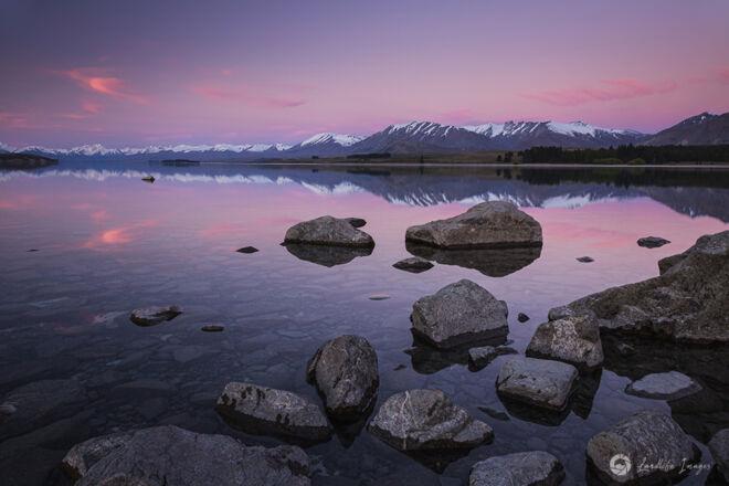 Reflective sunset at Lake Tekapo, New Zealand